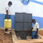 The Water Project: Ivakale Primary School & Community - Rain Tank 2 -  Pupils Collecting Water