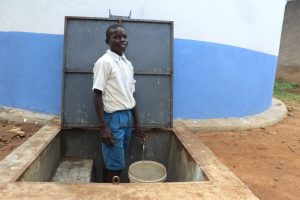 The Water Project:  Collecting Water From The Rain Tank