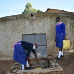 The Water Project: Bulukhombe Primary School -  Fetching Water From The Tank