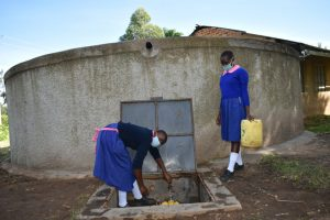 The Water Project:  Fetching Water From The Tank