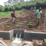 The Water Project: Mahira Community, Anunda Spring -  Grass Planting And Fencing