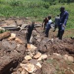 The Water Project: Mahira Community, Anunda Spring -  Stone Backfilling