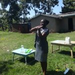 The Water Project: Mahira Community, Anunda Spring -  Facilitator Teaches Handwashing