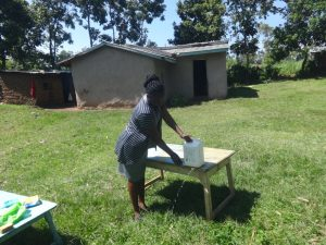 The Water Project:  Making A Leaky Tin For Handwashing