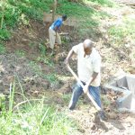 The Water Project: Maraba Community, Nambwaya Spring -  Backfilling With Soil Over The Tarp