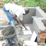 The Water Project: Maraba Community, Nambwaya Spring -  Fitting The Tiles