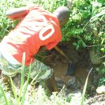 The Water Project: Maraba Community, Nambwaya Spring -  Identifying Spring Eyes During Excavation