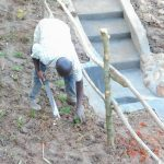 The Water Project: Maraba Community, Nambwaya Spring -  Planting Grass Above Catchment Area