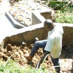 The Water Project: Maraba Community, Nambwaya Spring -  Reinforcing Headwall With Clay