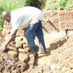 The Water Project: Maraba Community, Nambwaya Spring -  Stone Pitching