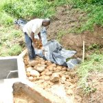 The Water Project: Maraba Community, Nambwaya Spring -  Adding Layer Of Small Rocks