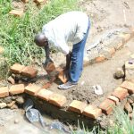 The Water Project: Maraba Community, Nambwaya Spring -  Brickwork Begins