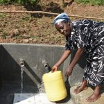 The Water Project: Maraba Community, Nambwaya Spring -  Easy Access Fetching Water