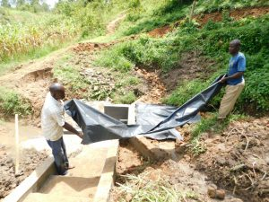 The Water Project:  Fitting The Tarp