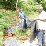 The Water Project: Maraba Community, Nambwaya Spring -  Fitting The Tarp