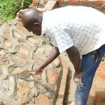 The Water Project: Maraba Community, Nambwaya Spring -  Plastering The Stone Pitching To Form Rub Wall