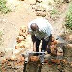 The Water Project: Maraba Community, Nambwaya Spring -  Setting The Pipes