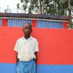 The Water Project: Ivakale Primary School & Community - Rain Tank 2 -  Brian Poses In Front Of The Latrines