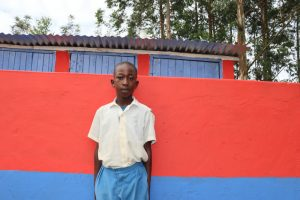The Water Project:  Brian Poses In Front Of The Latrines