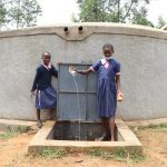 The Water Project: Kapkoi Primary School -  Girls Showing Clean Water Fetched From The Tank
