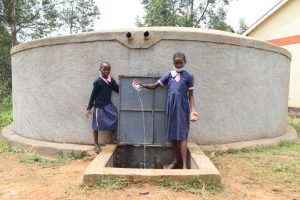 The Water Project:  Girls Showing Clean Water Fetched From The Tank