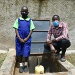 The Water Project: Boyani Primary School -  A Pupil And A Teacher Posing At The Water Tank