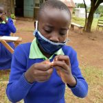 The Water Project: Boyani Primary School -  Following Handwashing Steps Keenly