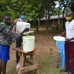 The Water Project: Boyani Primary School -  Refilling Handwashing Station