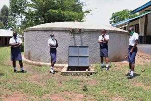 The Water Project:  Posing With The Rain Tank