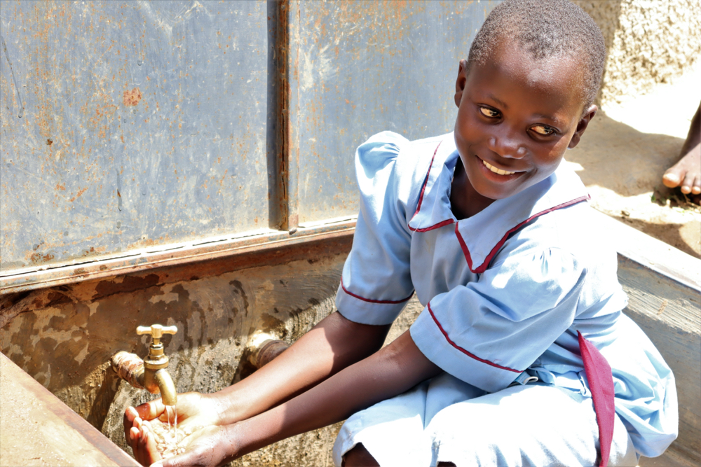 The Water Project : kenya20129-student-enjoys-water-at-the-tank