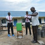 The Water Project: Kinu Friends Secondary School -  Trainer Victor Leads Handwashing Demonstration