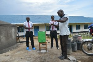 The Water Project:  Trainer Victor Leads Handwashing Demonstration