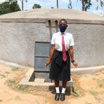 The Water Project: Kinu Friends Secondary School -  A Student Poses With The Tank