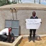 The Water Project: Kinu Friends Secondary School -  Pupil James Fetching Water From The Tank