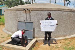 The Water Project:  Pupil James Fetching Water From The Tank