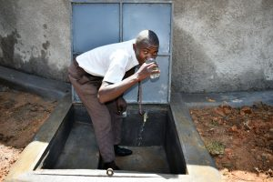 The Water Project:  A Student Enjoying Clean Water