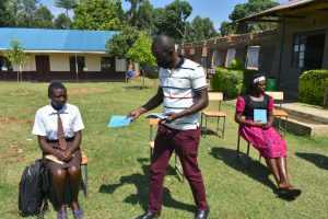 The Water Project:  Distributing Training Workbooks