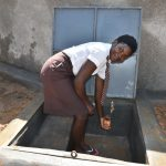 The Water Project: Friends Kisasi Secondary School -  Getting A Fresh Drink