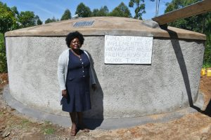 The Water Project:  Principal Florence Adenyi At The Tank