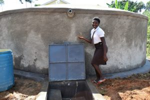The Water Project:  Student Posing By The Water Tank