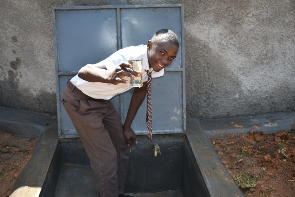 The Water Project : kenya20157-student-posing-with-water-at-drawing-point