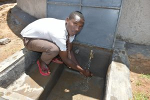 The Water Project:  Student Washing Hands At The Rain Tank