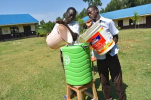 The Water Project:  Refilling Handwashing Station