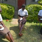 The Water Project: Friends Kisasi Secondary School -  Students Take Notes