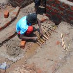 The Water Project: Mahira Community, Anunda Spring -  Water Escape Channel Construction
