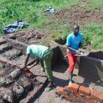 The Water Project: Mahira Community, Anunda Spring -  Plastering Spring Walls