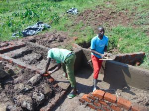 The Water Project:  Plastering Spring Walls