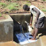 The Water Project: Mahira Community, Anunda Spring -  Collecting Water