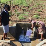 The Water Project: Mahira Community, Anunda Spring -  Field Officer Mary At The Spring