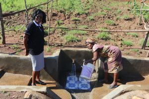 The Water Project:  Field Officer Mary At The Spring